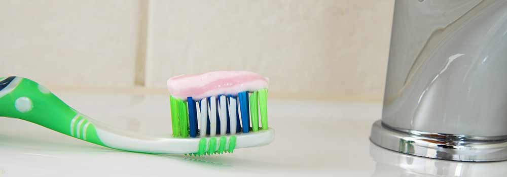 Natural toothpaste on toothbrush