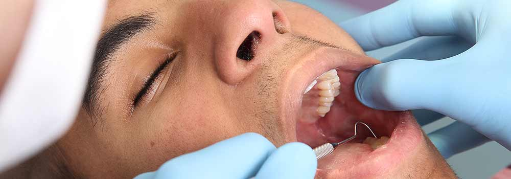 Patient having wisdom tooth inspected