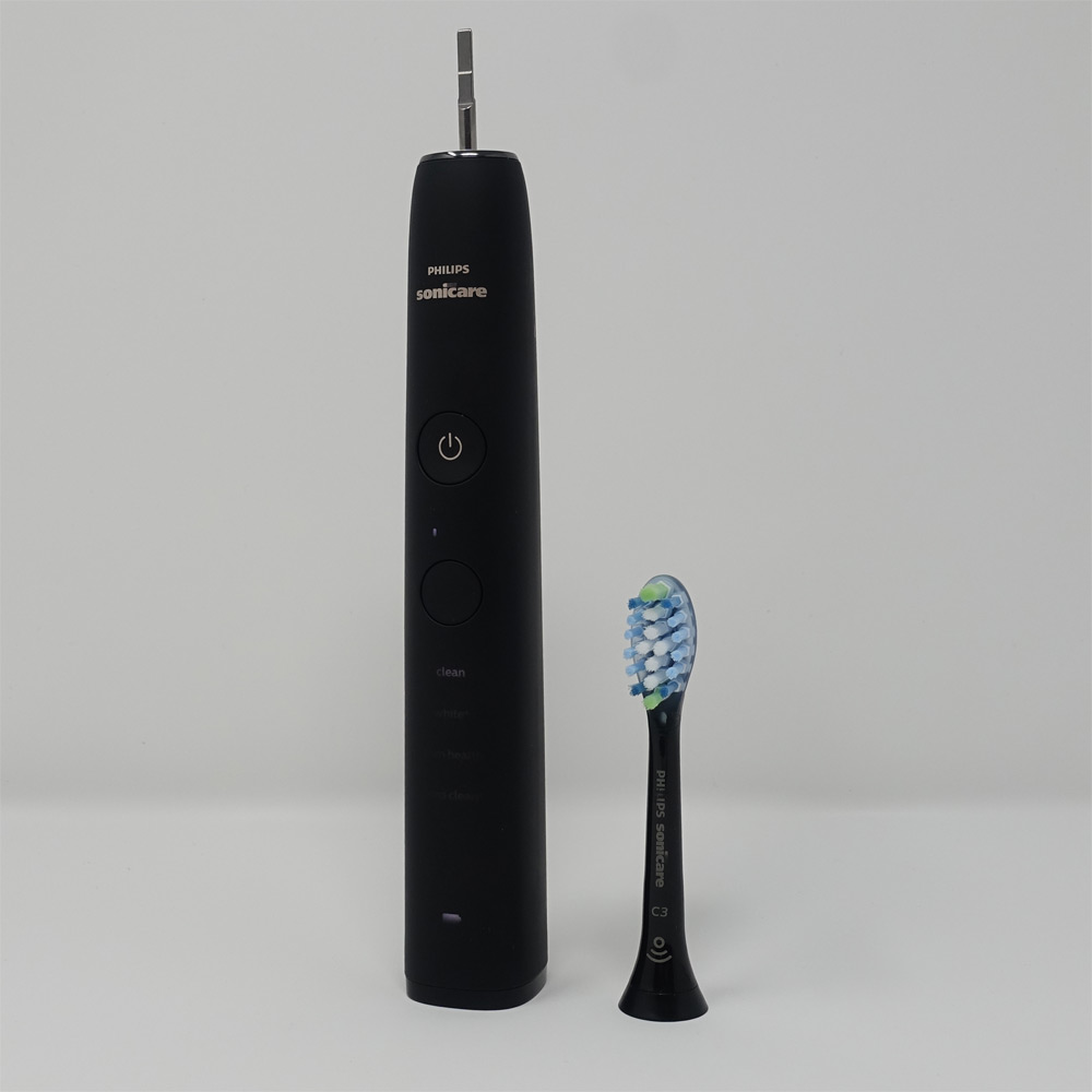 Sonicare DiamondClean 9000 brush handle with brush head detached.