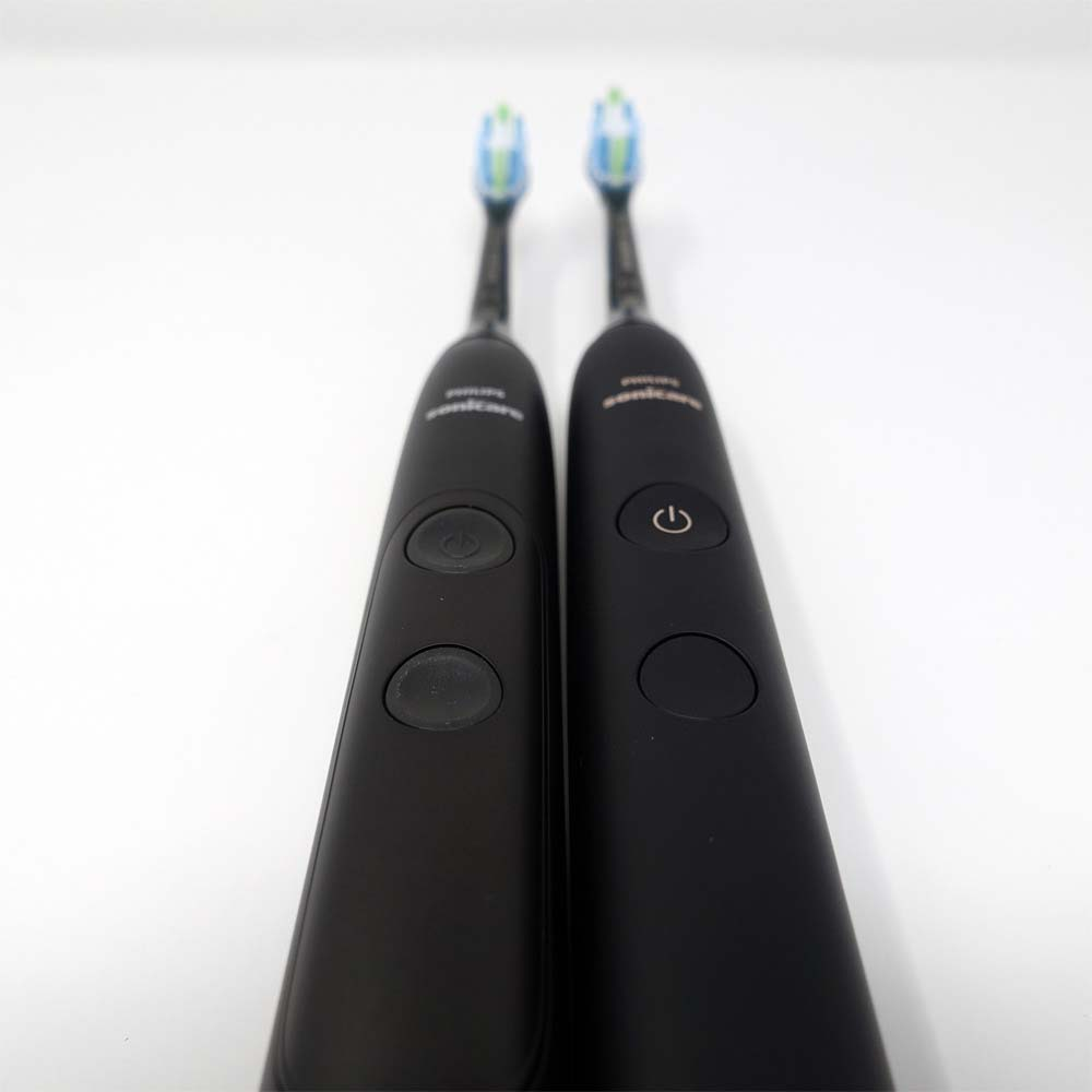 Sonicare ExpertClean laid flat next to Sonicare DiamondClean 9000.
