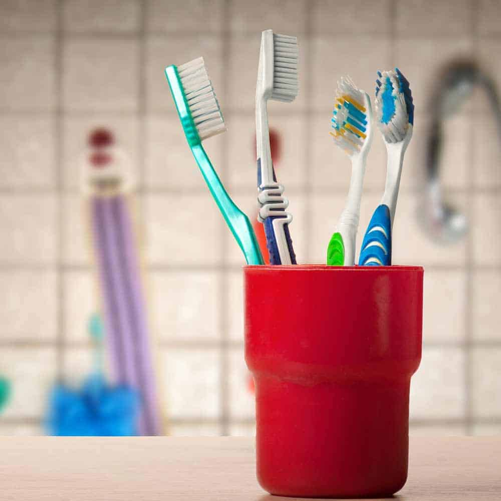 Multiple toothbrushes in cup