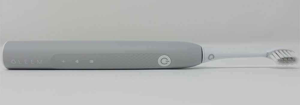GLEEM rechargeable toothbrush laid on its side